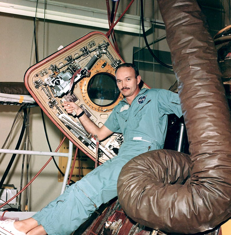 Man sits in space capsule