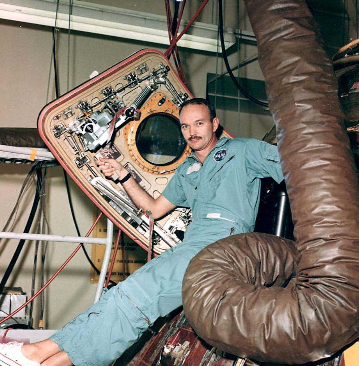 Man sits in space capsule