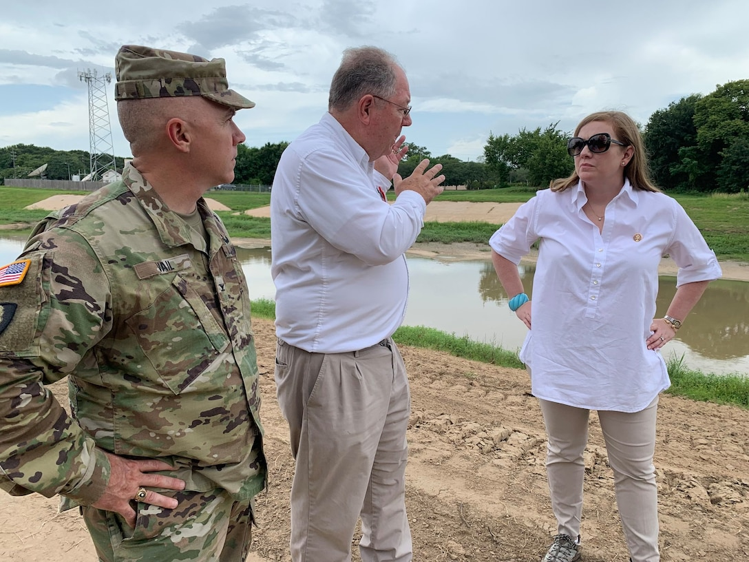 HOUSTON (July 3, 2019) Richard Long, a natural resources manager with the U.S. Army Corps of Engineers Galveston District, discusses the Fort Bend Drainage District to desilt Buffalo Bayou with 7th District U.S. Representative Lizzie Fletcher during a tour the Addicks and Barker reservoirs and dams with Col. Timothy Vail, Galveston District commander.