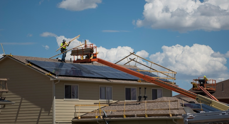 Construction workers replace the shingles on roofs at the Tierra Vista Communities at Schriever Air Force Base, Colorado, July 8, 2019. TVC's mission is to provide outstanding communities where military families live, work and thrive. (U.S. Air Force photo by Airman 1st Class Jonathan Whitely)