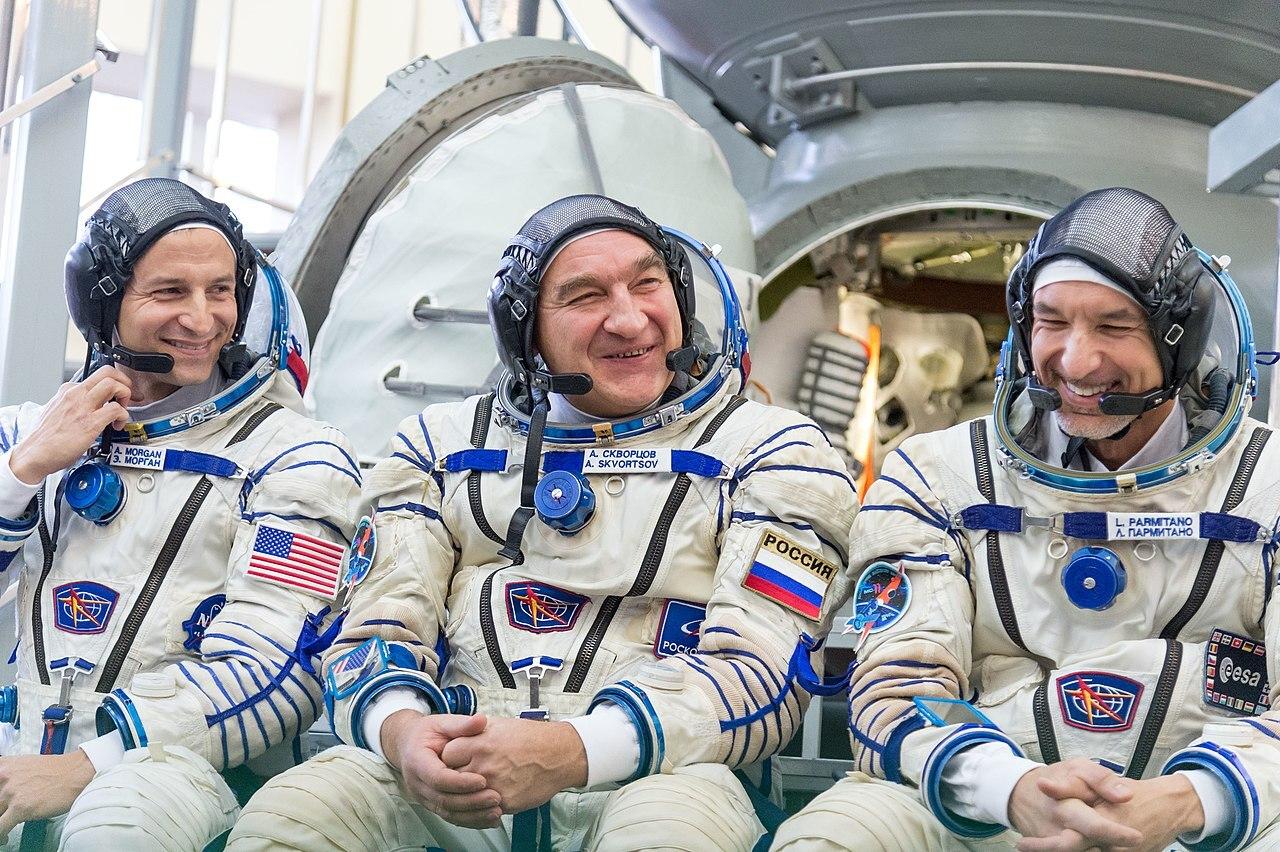 Three astronauts pose for photo.