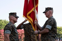 Outgoing commander of U.S. Marine Corps Forces Command (MARFORCOM) Lt. Gen. Mark A. Brilakis, right, relinquishes command to Lt. Gen. Robert F. Hedelund, the incoming MARFORCOM commanding general during the MARFORCOM change of command ceremony at Naval Support Activity Hampton Roads, Virginia, July 3, 2019. The change of command is a time-honored tradition where all responsibilities and authority are ceremoniously passed from one commander to another. MARFORCOM is one of three major Marine Corps commands, along with U.S. Marine Corps Forces, Pacific and U.S. Marine Corps Forces, Reserve, which generates operating forces to support Unified or Joint Task Force Commanders. (U.S. Marine Corps photo by Sgt. Jessika Braden/ Released)