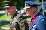 Marine Corps Gen. Joe Dunford, chairman of the Joint Chiefs of Staff, walks with Finnish Chief of Defense Air Force Gen. Jarmo Lindberg during a ceremony at Joint Base Fort Myer-Henderson Hall, Va., July 9, 2019.