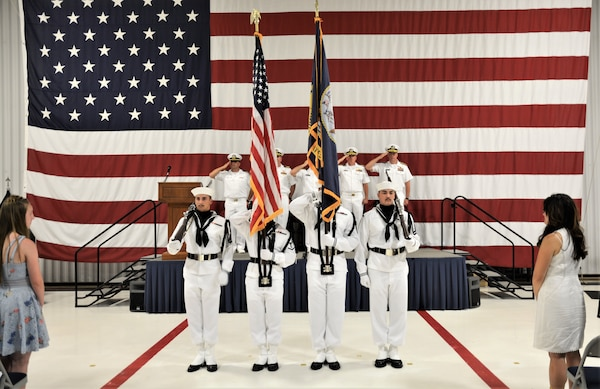 IMAGE: Ceremonial Color Guard members prepare to present colors prior to the national anthem. More than 200 Sailors and guests attended a traditional change of command ceremony at Naval Air Station (NAS) Oceana's Center for Naval Aviation Technical Training Unit's ceremonial hangar aboard NAS Oceana June 27 where Cmdr. Andrew Hoffman was relieved of command by Cmdr. Joseph Oravec. Oravec became the 28th commanding officer, Naval Surface Warfare Center Dahlgren Division, Dam Neck Activity.