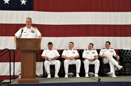 IMAGE: (Far left) Rear Adm. Eric Ver Hage, Commander NAVSEA Warfare Centers, speaks to more than 200 Sailors and guests attending a traditional Change of Command ceremony at Naval Air Station (NAS) Oceana's Center for Naval Aviation Technical Training Unit's ceremonial hangar aboard NAS Oceana June 27 where Cmdr. Andrew Hoffman was relieved of command by Cmdr. Joseph Oravec. Oravec became the 28th commanding officer, Naval Surface Warfare Center Dahlgren Division, Dam Neck Activity.