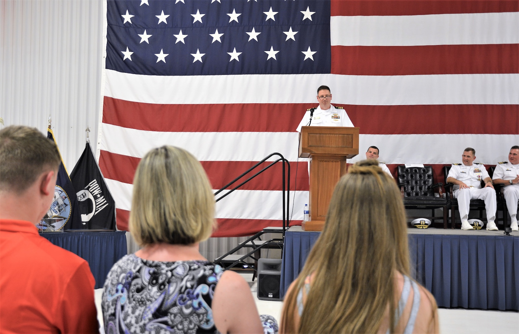 IMAGE: (Center) Cmdr. Joseph Oravec addresses more than 200 Sailors and guests after accepting command of Naval Surface Warfare Center Dahlgren Division, Dam Neck Activity from CDR Andrew Hoffman. The two naval officers held their traditional Change of Command ceremony at Naval Air Station (NAS) Oceana's Center for Naval Aviation Technical Training Unit's ceremonial hangar aboard NAS Oceana June 27. Oravec is the command's 28th commanding officer.
