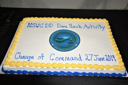 IMAGE: Cake and refreshments were available to guests following Naval Surface Warfare Center Dahlgren Division, Dam Neck Activity's Change of Command ceremony June 27. More than 200 Sailors and guests attended a traditional ceremony at Naval Air Station Oceana's Center for Naval Aviation Technical Training Unit's ceremonial hangar aboard NAS Oceana where Cmdr. Andrew Hoffman was relieved of command by Cmdr. Joseph Oravec, who became the command's 28th commanding officer.