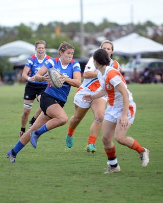 WILMINGTON, N.C. (June 6, 2019) -- Capt. Kate Herren carries the ball down the pitch during the Marine Corps-Coast Guard rugby match on day two of the inaugural Armed Forces Women's Rugby Championship held in Wilmington, N.C. July 5-7, 2019. This historic event features the best female rugby players from the Army, Marine Corps, Navy, Air Force, and Coast Guard, who will compete for the title of the first ever Women's Rugby Champs (U.S. Dept. of Defense photo by Chief Mass Communication Specialist Patrick Gordon/RELEASED)