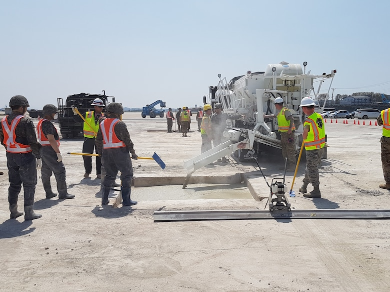 The Arctic Engineers of the 673d Civil Engineer Group, work alongside Republic of Korea Air Force engineers during a week-long base resiliancy training event at Gwangju Air Base, Korea, April 15, 2019. The purpose of the event was to train and execute integrated base contingency operations focused on recovering the airfield after an attack.(Courtesy photo)