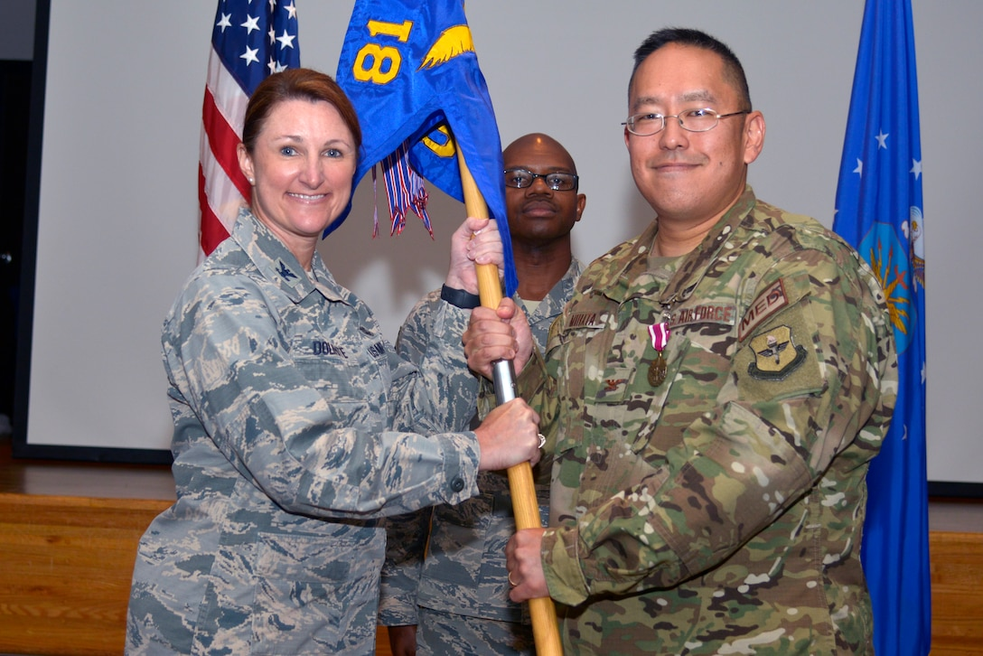 U.S. Air Force Col. Beatrice Dolihite, 81st Medical Group commander, receives the 81st Surgical Operations Squadron guidon from Col. Ryan Mihata, outgoing 81st MSGS commander, during the 81st MSGS change of command ceremony inside the Don Wylie Auditorium at Keesler Air Force Base, Mississippi, July 9, 2019. The passing of the guidon is a ceremonial symbol of exchanging command from one commander to another. Mihata passed on command of the 81st MSGS to Lt. Col. Norris Jackson. (U.S. Air Force photo by Airman Seth Haddix)