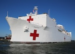 A view of the U.S. Navy Hospital Ship USNS Comfort as it departs Naval Station Norfolk, June 14.