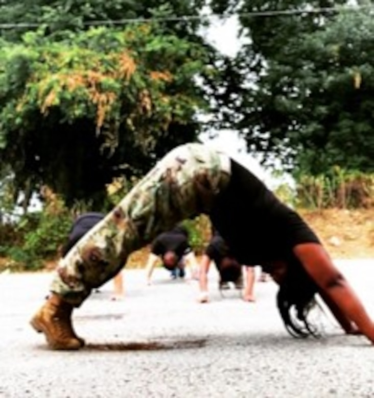 Female bent over in exercise class.