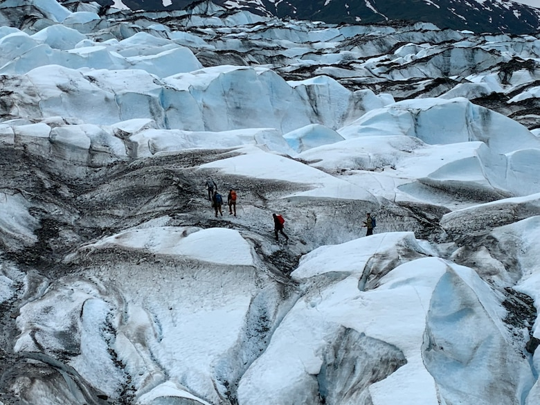 Recovery team members traverse Colony Glacier, Alaska, June 2019. The recovery team was searching for remains from a C-124 Globemaster II that crashed into Gannett Mountain, Alaska, on Nov. 22, 1952, while flying from McChord Air Force Base, Washington, to Elmendorf Air Force Base, Alaska resulting in the loss of 52 service members. (Courtesy photo)