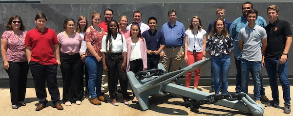 IMAGE: DAHLGREN, Va. (July 2, 2019) - Students from Virginia and Maryland high schools participating in the Science and Engineering Apprenticeship Program at Naval Surface Warfare Center (NSWC) Dahlgren Division and NSWC Indian Head Explosive Ordnance Disposal Technology Division pause - with an engineer from both commands - in front of the Potomac River Test Range metal map during their tour.
