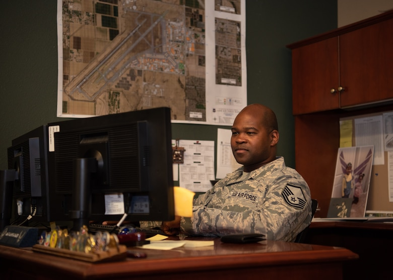 Master Sgt. Antonio Montgomery, 56th Fighter Wing Flight Safety Office flight safety noncommissioned officer, finishes a safety report July 9, 2019, at Luke Air Force Base, Ariz. The flight safety office oversees the safety of the operations on the flightline, including the Airmen, aircraft and runway, ensuring the day-to-day operations are not hindered. (U.S. Air Force photo by Airman 1st Class Aspen Reid)