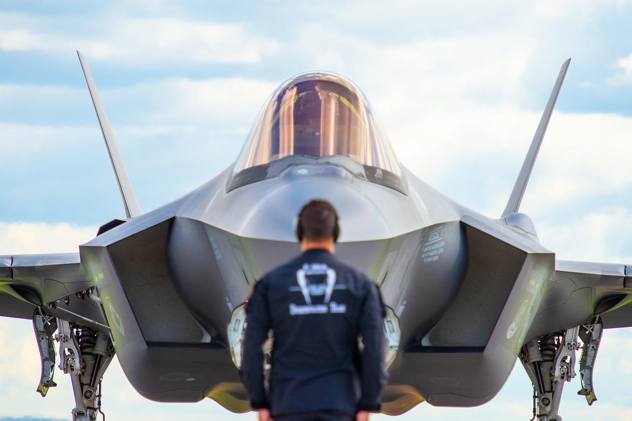 Alt Text: F-35 prepares to launch.