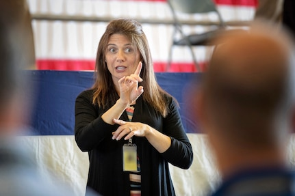 Marlene Bell, an American Sign Language Interpreter with Code 900A, Administrative Support, facilitates communication for deaf and hearing impaired employees at Puget Sound Naval Shipyard & Intermediate Maintenance Facility.