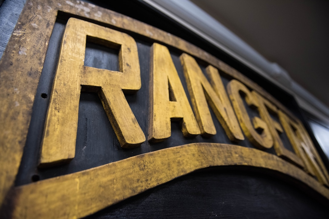 A Ranger sign hangs up inside at a training camp near Schofield Barracks, Oahu, Hawaii, May 13, 2019. Twenty-three Airmen from across the Air Force recently converged on a training camp for a three-week Ranger Assessment Course near Schofield Barracks, May 12-31, 2019. The purpose of the 19-day course is to prepare, assess and evaluate Air Force candidates for Army Ranger School. (U.S. Air Force photo by Staff Sgt. Hailey Haux)