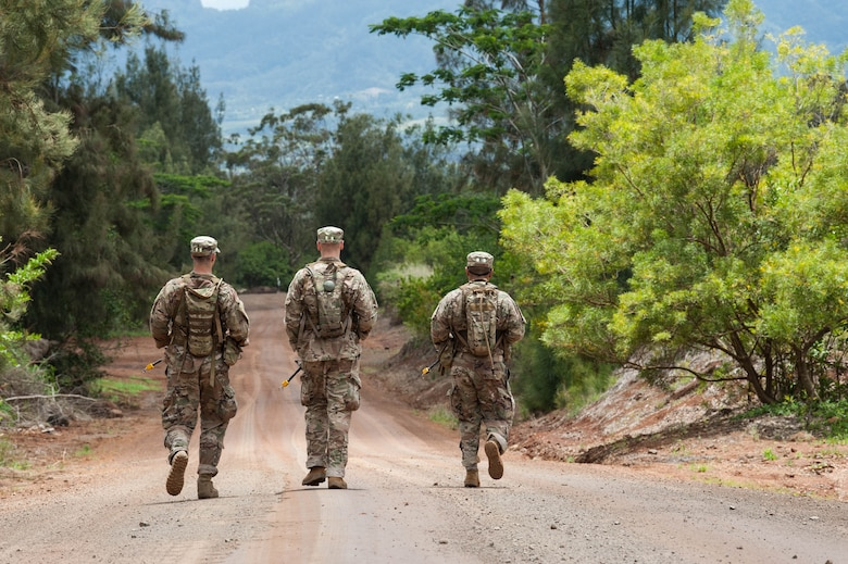 1st Lt. Austin Hoover, Tech. Sgt. Alexander Morley, and Staff Sgt. Jose Obregon, Ranger Assessment Course students, conduct land navigation during as one of their first tasks during the Ranger Assessment Course near Schofield Barracks, Oahu, Hawaii, May 13, 2019. The purpose of the 19-day course is to prepare, assess and evaluate Air Force candidates for Army Ranger School. The Airmen who pass the RAC gain more than a ticket into Ranger School and knowledge on Army tactics – they learn to lead. (U.S. Air Force photo by Staff Sgt. Hailey Haux)