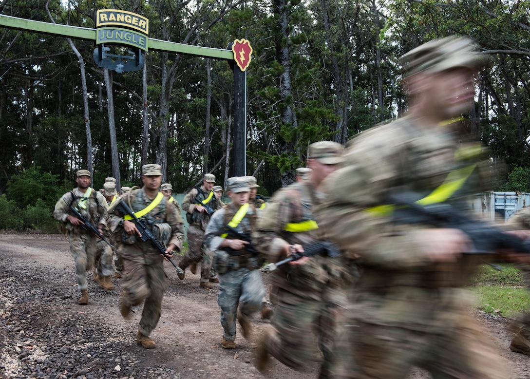 Airmen begin a two-mile run for a Ranger Assessment Course through the hills of a training camp near Schofield Barracks, Oahu, Hawaii, May 20, 2019. The purpose of the 19-day course is to prepare, assess and evaluate Air Force candidates for Army Ranger School. Of the 23 Airmen who began the Ranger Assessment Course, three dropped for personal motivational reasons and one dropped for medical reasons, leaving 19 standing at the end. Out of the 19, 11 Airmen met all the standards needed for a recommendation to go forward to Ranger School. (U.S. Air Force photo by Staff Sgt. Hailey Haux)