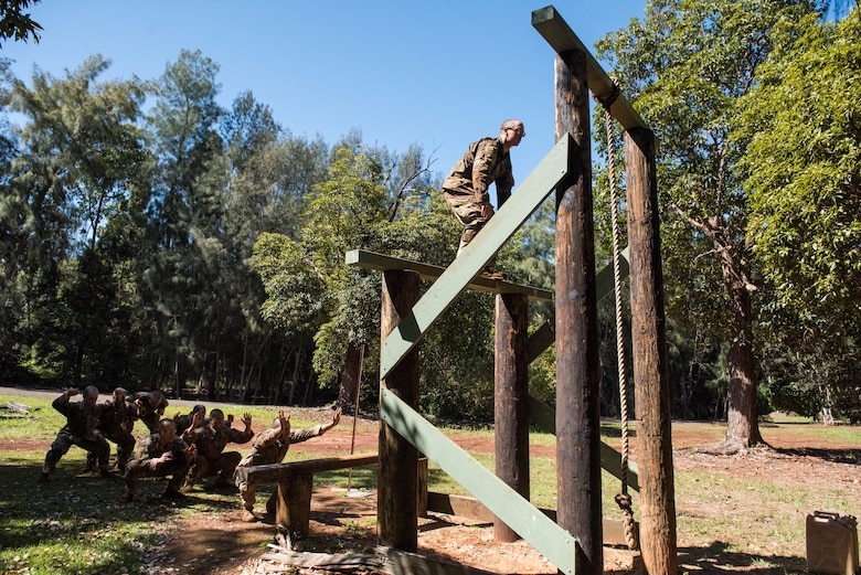 1st Lt. Austin Drake, Ranger Assessment Course student, prepares to jump to the next rung on an obstacle course during training near Schofield Barracks, Oahu, Hawaii, May 20, 2019. The purpose of the 19-day course is to prepare, assess and evaluate Air Force candidates for Army Ranger School. Of the 23 Airmen who began the Ranger Assessment Course, three dropped for personal motivational reasons and one dropped for medical reasons, leaving 19 standing at the end. Out of the 19, 11 Airmen met all the standards needed for a recommendation to go forward to Ranger School. (U.S. Air Force photo by Staff Sgt. Hailey Haux)