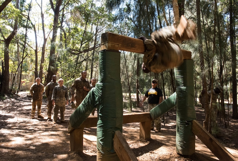 Airmen go through an obstacle course during a Ranger Assessment Course near Schofield Barracks, Oahu, Hawaii, May 20, 2019. The Airmen who pass the RAC gain more than a ticket into Ranger School and knowledge on Army tactics – they learn to lead. Throughout the course, Airmen were tested on their ability to perform land navigation, ambush, react to contact and squad attacks. Along with those assessments, the students went on runs and marches of different distances – all leading up to a 12-mile ruck march two days before graduation. (U.S. Air Force photo by Staff Sgt. Hailey Haux)