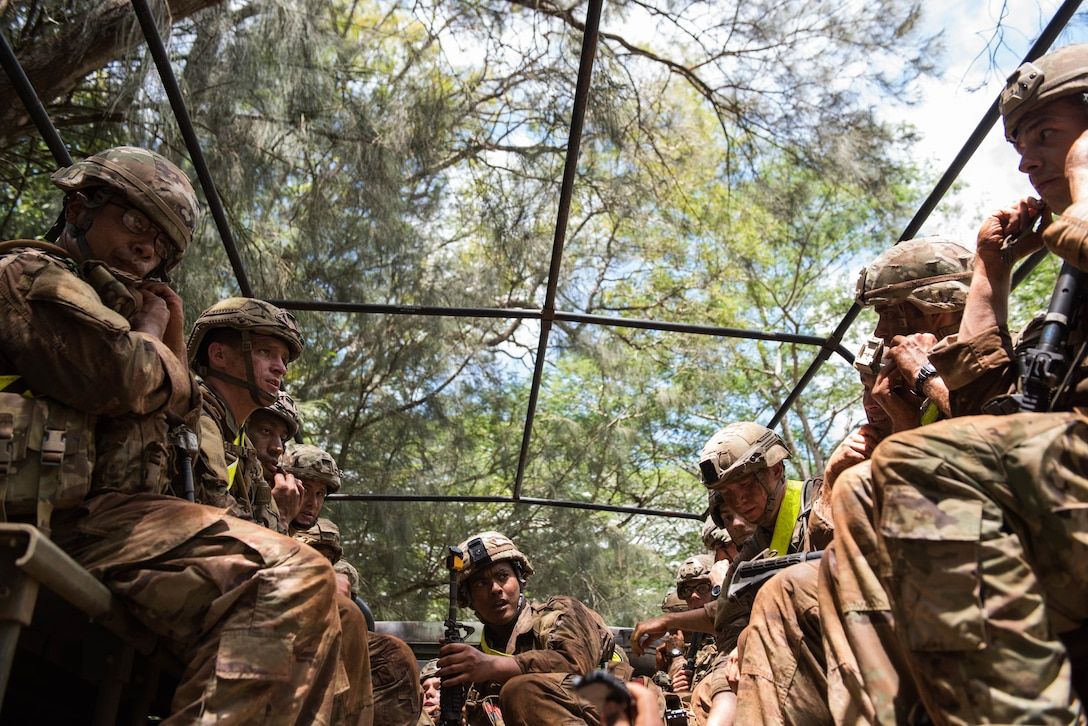 Ranger Assessment Course students prepare to ride back to camp after going through the obstacle course near Schofield Barracks, Oahu, Hawaii, May 20, 2019. Twenty-three Airmen from across the Air Force recently converged on a training camp for a three-week Ranger Assessment Course near Schofield Barracks, May 12-31, 2019. The purpose of the 19-day course is to prepare, assess and evaluate Air Force candidates for Army Ranger School. (U.S. Air Force photo by Staff Sgt. Hailey Haux)