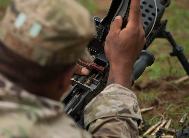 Tech. Sgt. Justin Stinson, Ranger Assessment Course student, loads his weapon and practices un-jamming it during the RAC near Schofield Barracks, Oahu, Hawaii, May 20, 2019. The Airmen who pass the Ranger Assessment Course gain more than a ticket into Ranger School and knowledge on Army tactics – they learn to lead. Throughout the course, Airmen were tested on their ability to perform land navigation, ambush, react to contact and squad attacks. Along with those assessments, the students went on runs and marches of different distances – all leading up to a 12-mile ruck march two days before graduation. (U.S. Air Force photo by Staff Sgt. Hailey Haux)