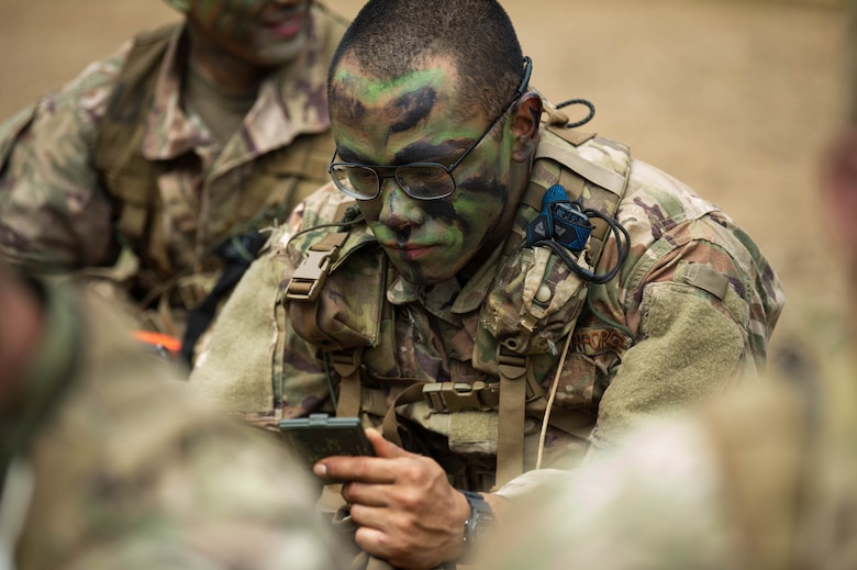 Staff Sgt. Jose Obregon, Ranger Assessment Course student, applies face camouflage before going into the field near Schofield Barracks, Oahu, Hawaii, May 23, 2019.  The Airmen who pass the Ranger Assessment Course gain more than a ticket into Ranger School and knowledge on Army tactics – they learn to lead. (U.S. Air Force photo by Staff Sgt. Hailey Haux)