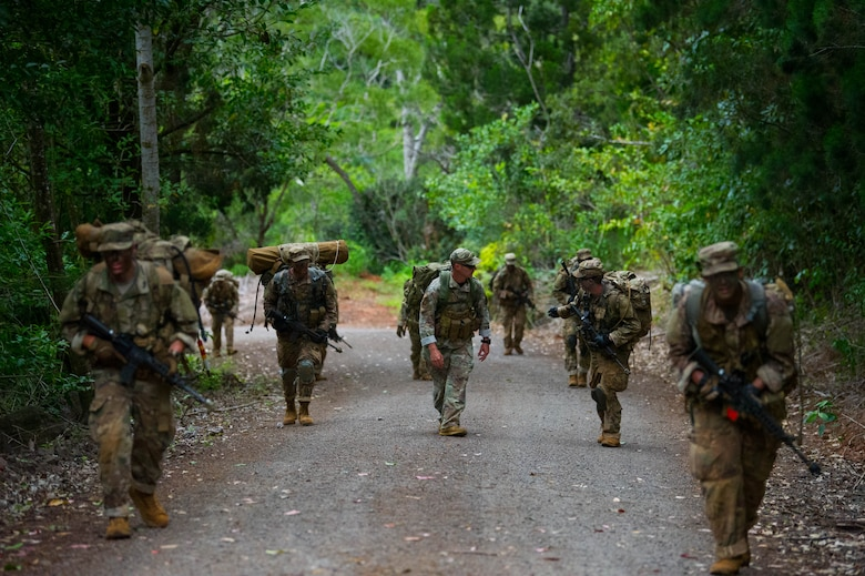 Ranger Assessment Course students ruck march along the road during training near Schofield Barracks, Oahu, Hawaii, May 23, 2019. Twenty-three Airmen from across the Air Force recently converged on a training camp for a three-week Ranger Assessment Course May 12-31, 2019. (U.S. Air Force photo by Staff Sgt. Hailey Haux)