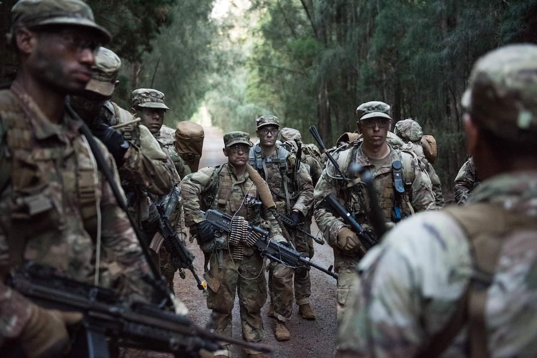 Ranger Assessment Course students are instructed on the prime locations for an ambush during training near Schofield Barracks, Oahu, Hawaii, May 23, 2019. Twenty-three Airmen from across the Air Force recently converged on a training camp for a three-week Ranger Assessment Course May 12-31, 2019. (U.S. Air Force photo by Staff Sgt. Hailey Haux)