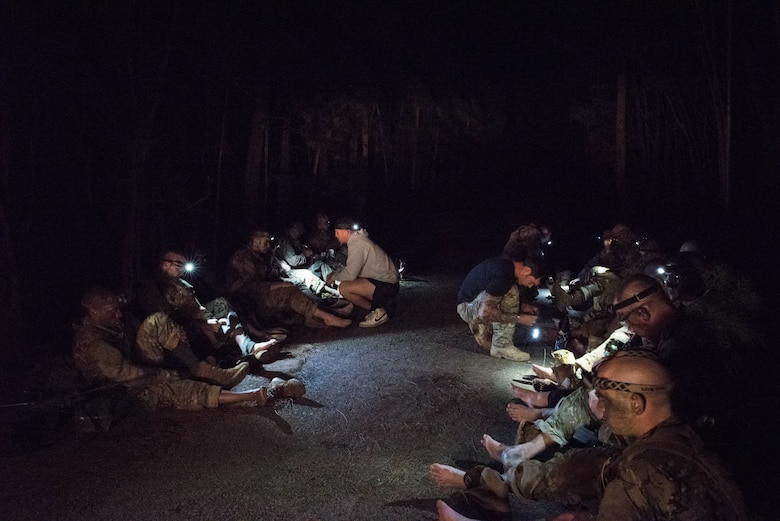 Ranger Assessment Course students have their feet looked at by RAC cadre and medical personnel after a day in the field near Schofield Barracks, Oahu, Hawaii, May 23, 2019. The Airmen who pass the Ranger Assessment Course gain more than a ticket into Ranger School and knowledge on Army tactics – they learn to lead. Throughout the course, Airmen were tested on their ability to perform land navigation, ambush, react to contact and squad attacks. Along with those assessments, the students went on runs and marches of different distances – all leading up to a 12-mile ruck march two days before graduation. (U.S. Air Force photo by Staff Sgt. Hailey Haux)