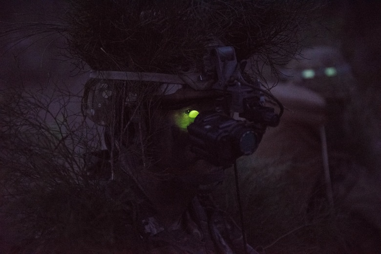 Senior Airman Kimball Butler, Ranger Assessment Course student, dons his night vision gear and prepares for a simulated ambush during training near Schofield Barracks, Oahu, Hawaii, May 23, 2019. Twenty-three Airmen from across the Air Force recently converged on a training camp for a three-week Ranger Assessment Course May 12-31, 2019. The purpose of the 19-day course is to prepare, assess and evaluate Air Force candidates for Army Ranger School. (U.S. Air Force photo by Staff Sgt. Hailey Haux)