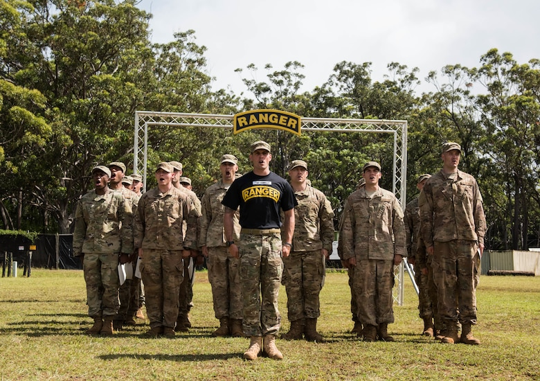 Tech. Sgt. Keegan Donnelly, Ranger Assessment Course lead cadre, and RAC students recite the Ranger Creed during the graduation ceremony near Schofield Barracks, Oahu, Hawaii, May 31, 2019. The purpose of the three-week course is to prepare, assess and evaluate Air Force candidates for Army Ranger School. Of the 23 Airmen who began the Ranger Assessment Course, three dropped for personal motivational reasons and one dropped for medical reasons, leaving 19 standing at the end. Out of the 19, 11 Airmen met all the standards needed for a recommendation to go forward to Ranger School. (U.S. Air Force photo by Staff Sgt. Hailey Haux)