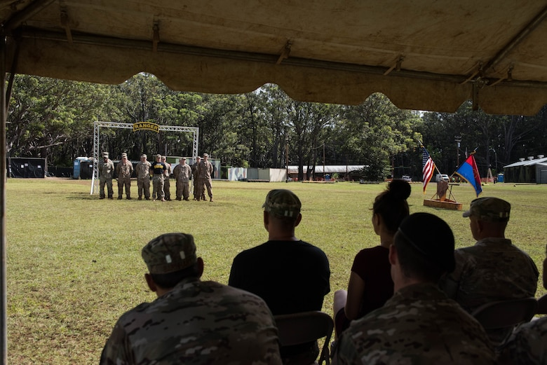 Friends, family members and co-workers watch as the newest students graduate from the Ranger Assessment Course near Schofield Barracks, Oahu, Hawaii, May 31, 2019. Throughout the 19-day course, Airmen were tested on their ability to perform land navigation, ambush, react to contact and squad attacks. Along with those assessments, the students went on runs and marches of different distances – all leading up to a 12-mile ruck march two days before graduation. (U.S. Air Force photo by Staff Sgt. Hailey Haux)