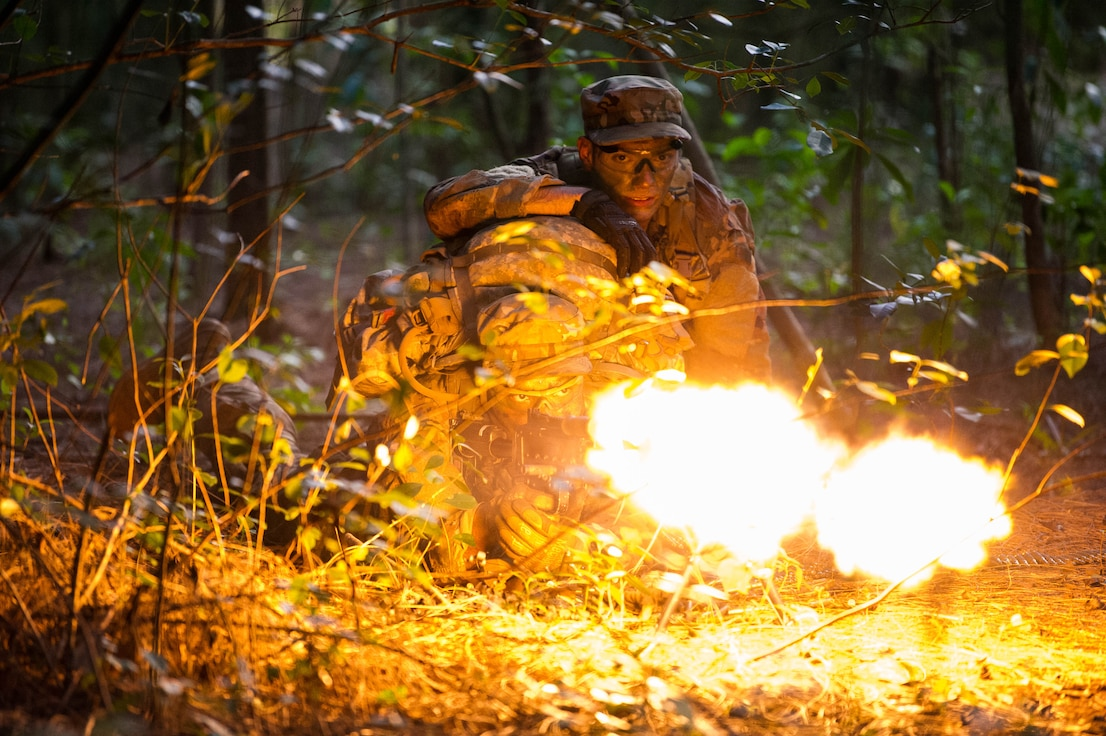 Staff Sgts. Jose Obregon and Joseph Pace, Ranger Assessment Course students, fire on opposing forces during a simulated react to contact near Schofield Barracks, Oahu, Hawaii, May 23, 2019. Twenty-three Airmen from across the Air Force recently converged on a training camp for a three-week Ranger Assessment Course May 12-31, 2019. The Airmen who pass the Ranger Assessment Course gain more than a ticket into Ranger School and knowledge on Army tactics – they learn to lead. (U.S. Air Force photo by Staff Sgt. Hailey Haux)