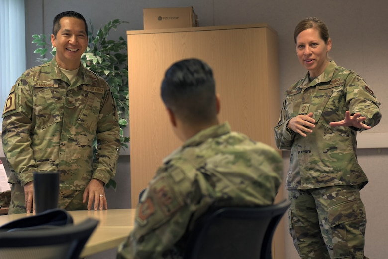 U.S. Air Force Col. Troy Pananon, 100th Air Refueling Wing commander, and Chief Master Sgt. Kathi Glascock, 100th ARW command chief, speak with Staff Sgt. Kristina Santos, 100th Security Forces military working dog trainer, during a reintegration briefing at RAF Mildenhall, England, July 9, 2019. Reintegration briefings occur when Airmen return from deployments to help them re-adjust to post deployment life. (U.S. Air Force photo by Senior Airman Benjamin Cooper)