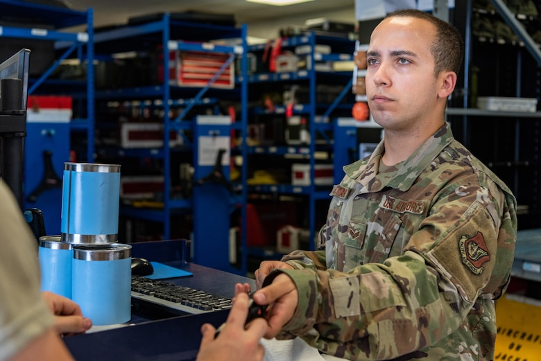 U.S. Air Force Senior Airman Adam Alvarez Martinez, F-15C Eagle support journeyman assigned to the 44th Aircraft Maintenance Unit, signs out tools during shift turnover June 27, 2019, on Kadena Air Base, Japan.