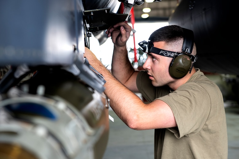 A 492nd Aircraft Maintenance Unit weapons load crew member inspects an armed F-15E Strike Eagle during the 48th Fighter Wing 2019 second quarter Load Crew competition at Royal Air Force Lakenheath, England, July 3, 2019. The 48th Maintenance Group holds quarterly load crew competitions to give Airmen a chance to show off their technical prowess to peers and wing leadership. (U.S. Air Force photo by Senior Airman Malcolm Mayfield)