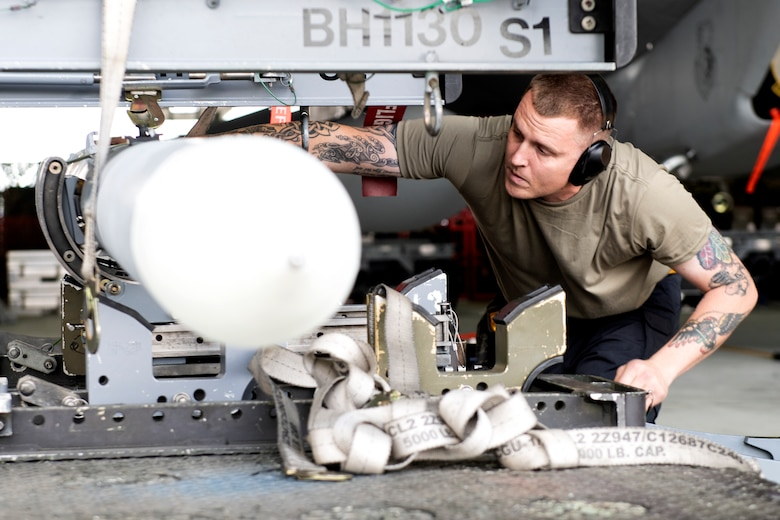 A 493rd Aircraft Maintenance Unit weapons load crew member prepares ordnance to be loaded onto an F-15C Eagle during the 48th Fighter Wing 2019 second quarter Load Crew competition at Royal Air Force Lakenheath, England, July 3, 2019. The 48th Maintenance Group holds quarterly load crew competitions to give Airmen a chance to show off their technical prowess to peers and wing leadership. (U.S. Air Force photo by Senior Airman Malcolm Mayfield)