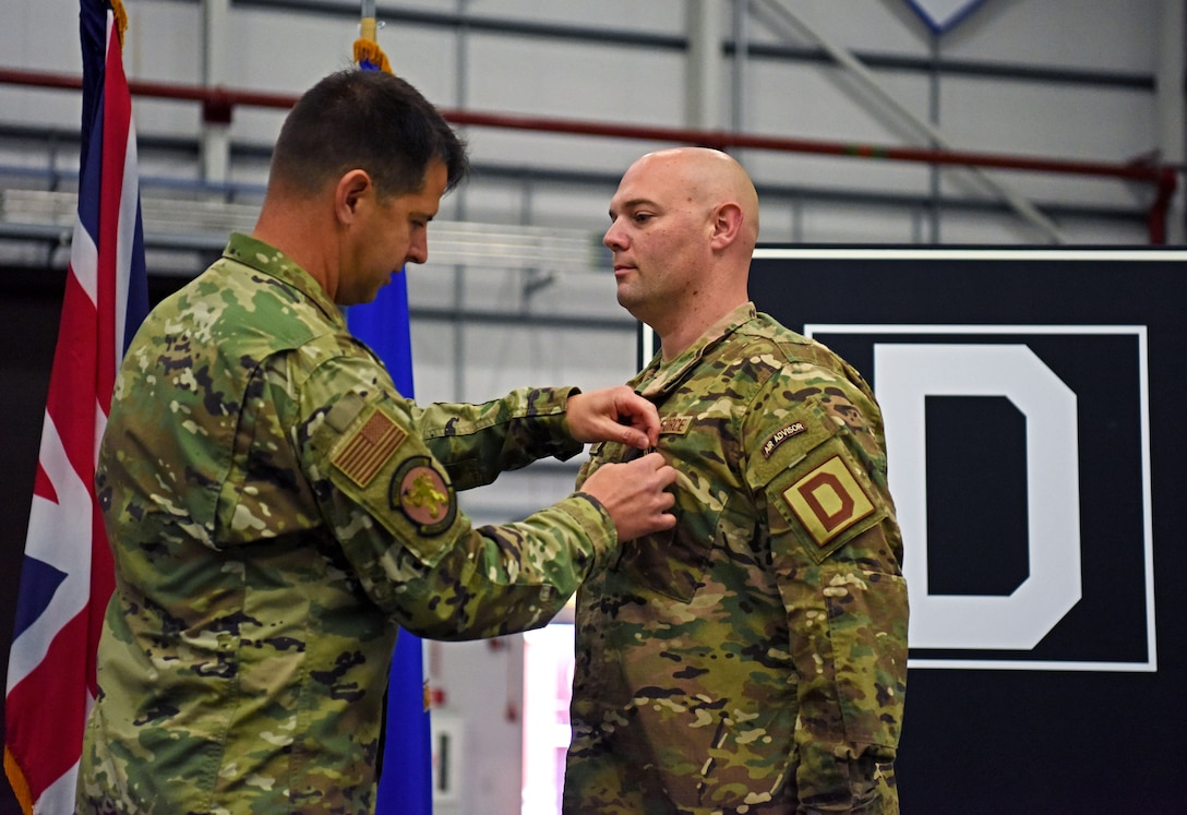 U.S. Air Force Lt. Col. Paul Weme, 100th Maintenance Group commander, pins a Bronze Star Medal on Maj. Aaron Darty, 100th Maintenance Squadron operations officer, during a ceremony held at RAF Mildenhall, England, July 1, 2019. Darty was recently awarded the Bronze Star Medal for meritorious achievement as operations officer and maintenance advisor in support of Operation Freedom Sentinel while deployed to Kandahar Airfield, Afghanistan. (U.S. Air Force photo by Airman 1st Class Brandon Esau)