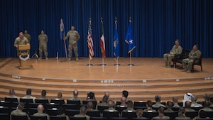 U.S. Air Force Col. Rodney Simpson addresses the audience after assuming command of the 386th Air Expeditionary Wing at Ali Al Salem Air Base, Kuwait, July 11, 2019. Simpson was previously assigned to Air Mobility Command, Scott Air Force Base, Ill. (U.S. Air Force photo by Tech. Sgt. Daniel Martinez)