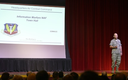Gen. Mike Holmes, commander of Air Combat Command, greets attendees at a town hall meeting to discuss the future 24th and 25th Air Force merger at Joint Base San Antonio-Lackland July 8. The merged information warfare numbered air force will integrate cyberspace and intelligence, surveillance and reconnaissance to best deliver information warfare capabilities and effects.