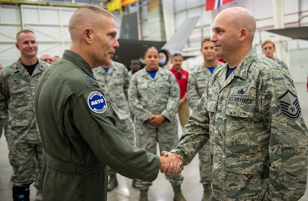 U.S. Air Force Lt. Gen. Steven Kwast, commander of Air Education and Training Command, meets with an Airman assigned to the 56th Fighter Wing at Luke Air Force Base, Arizona, during a visit July 20, 2018. Kwast, a U.S. Air Force Academy graduate, will pass command of AETC to Lt. Gen. Brad Webb July 26, 2019.