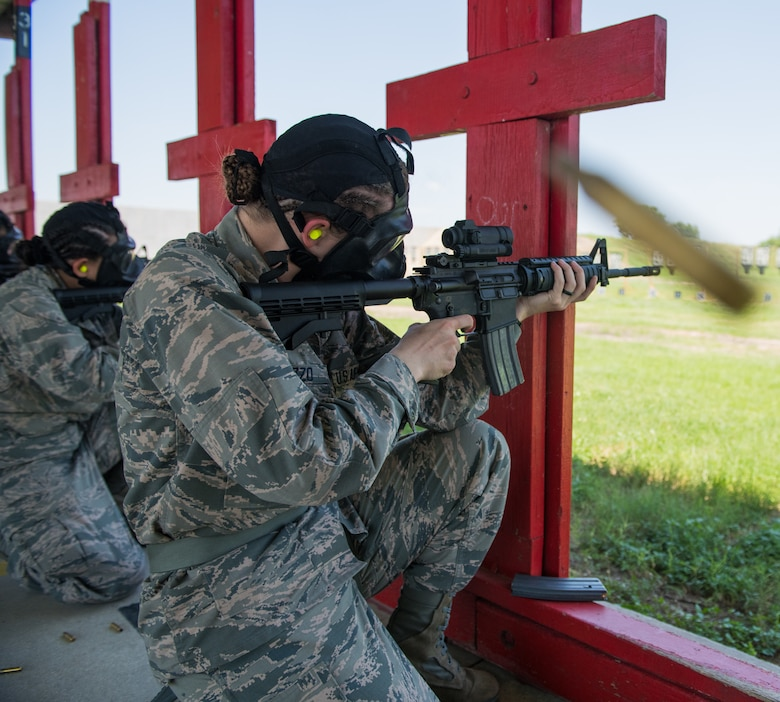 Air Force Basic Military Training trainees fire their M-4 Carbine during a weapons familiarization course June 8 at Joint Base San Antonio-Medina Annex. The firing range allows instructors to train 244 BMT trainees daily, four days a week, qualifying more than 40,000 BMT trainees in the M-4 carbine annually.