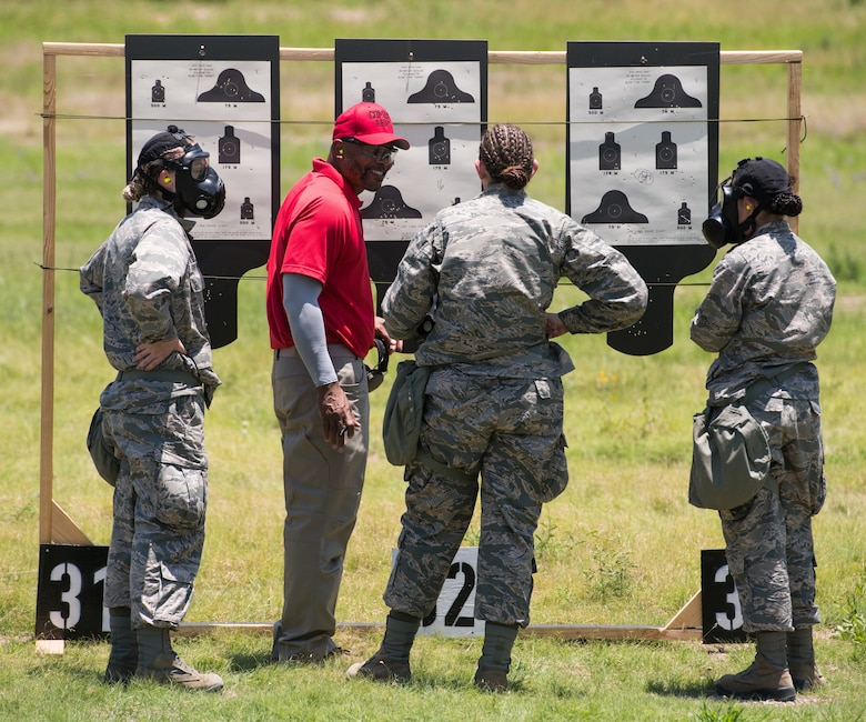 Nate Cade, 37th Training Support Squadron combat arms instructor, evaluates targets with Basic Military Training trainees during a weapons familiarization course July 8 at Joint Base San Antonio-Medina Annex. The firing range allows instructors to train 244 BMT trainees daily, four days a week, qualifying more than 40,000 BMT trainees in the M-4 carbine annually.