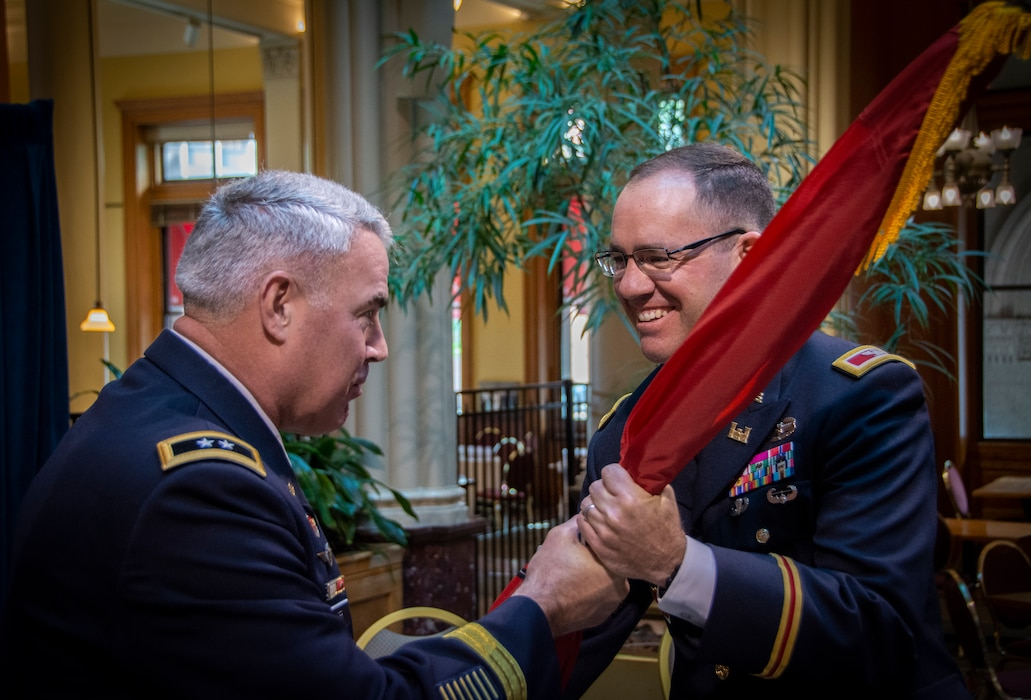 two army officers conduct a change of command ceremony