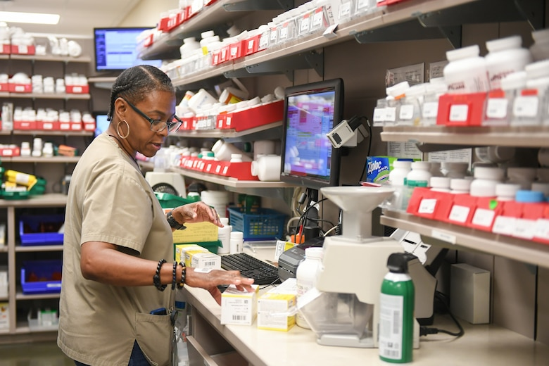 Crystal Coats, pharmacy technician, prepares prescriptions at the Staff Sgt. Derek F. Ramos Satellite Pharmacy located inside the AAFES Base Exchange at Hill Air Force Base, Utah, July 10, 2019. (U.S. Air Force photo by Cynthia Griggs)