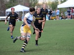 WILMINGTON, N.C. (June 6, 2019) -- Army faces off against Navy on day two of the inaugural Armed Forces Women's Rugby Championship held in Wilmington, N.C. July 5-7, 2019. This historic event features the best female rugby players from the Army, Marine Corps, Navy, Air Force, and Coast Guard, who will compete for the title of the first ever Women's Rugby Champs (U.S. Dept. of Defense photo by Chief Mass Communication Specialist Patrick Gordon/RELEASED)