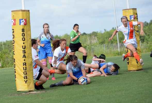 WILMINGTON, N.C. (June 6, 2019) -- Air Force faces off against Coast Guard on day two of the inaugural Armed Forces Women's Rugby Championship held in Wilmington, N.C. July 5-7, 2019. This historic event features the best female rugby players from the Army, Marine Corps, Navy, Air Force, and Coast Guard, who will compete for the title of the first ever Women's Rugby Champs (U.S. Dept. of Defense photo by Chief Mass Communication Specialist Patrick Gordon/RELEASED)
